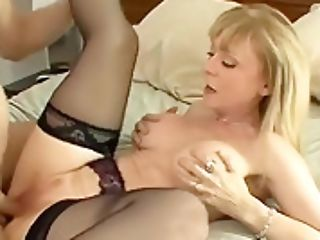 Chesty Cougar Entices In Stockings And A Garter