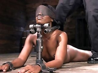 Ana Foxxx Is Blinded And Spanked On A Hard Wood Floor