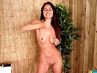 Desirable Black-haired Gal Unclothing Invitingly In Solo Erotic Flick