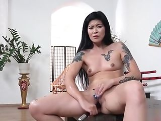 Hot Geisha Urinating And Dildoing Herself