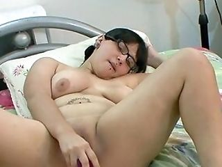 Chunky Asian Woman In Glasses Playthings With Her Big Clean-shaved Labia